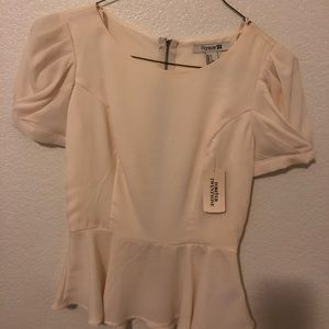 Cream peplum too with ruched sleeves